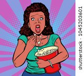 woman watching a scary movie... | Shutterstock .eps vector #1045203601