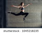 fit young woman jumping dancing ... | Shutterstock . vector #1045218235