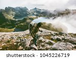 backpacker man hiking in... | Shutterstock . vector #1045226719