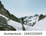 climber man with ice axe... | Shutterstock . vector #1045232005