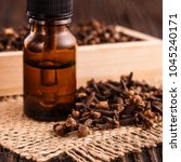 essential oil of cloves on a... | Shutterstock . vector #1045240171