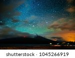 starry sky and the volcano of... | Shutterstock . vector #1045266919