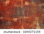 rusty steel sheet with heavy... | Shutterstock . vector #1045271155