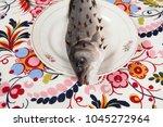 a bass fish with rosebush ...