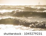 Ocean Waves Under The Sunset...
