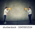 businessmen screaming into a... | Shutterstock . vector #1045301524