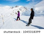 two snowboarders on the piste... | Shutterstock . vector #1045318399