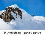 a skier is standing at the edge.... | Shutterstock . vector #1045318405