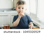 beautiful baby sitting in the... | Shutterstock . vector #1045320529