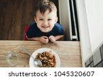 beautiful cute baby eats rice... | Shutterstock . vector #1045320607