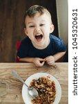 beautiful cute baby eats rice... | Shutterstock . vector #1045320631