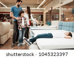blissful family buys new... | Shutterstock . vector #1045323397