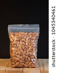almond in a zipper bag on wood... | Shutterstock . vector #1045340461