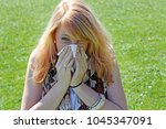 a young woman has hay fever.... | Shutterstock . vector #1045347091