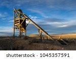 abandoned mine head frame over... | Shutterstock . vector #1045357591