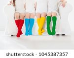 kids wearing colorful rainbow... | Shutterstock . vector #1045387357