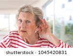 elderly lady with hearing... | Shutterstock . vector #1045420831