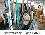 milking cows on farm  man and... | Shutterstock . vector #104545871