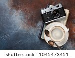 coffee cup and retro camera... | Shutterstock . vector #1045473451