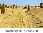 Car tracks in the Pinnacles desert Australia - stock photo