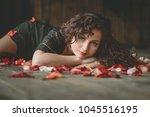 beautiful girl. rose petals.... | Shutterstock . vector #1045516195