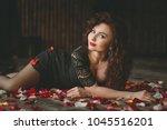 beautiful girl. rose petals.... | Shutterstock . vector #1045516201