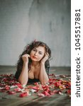 beautiful girl. rose petals.... | Shutterstock . vector #1045517881