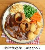 Traditional British Sunday roast beef dinner - stock photo