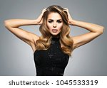 beautiful young woman with long ... | Shutterstock . vector #1045533319