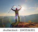 be winner. man tourist after...   Shutterstock . vector #1045536301