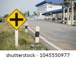 warning sign intersection ahead ... | Shutterstock . vector #1045550977