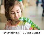 pretty little girl with iguana... | Shutterstock . vector #1045572865