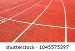 red running track on athletic...   Shutterstock . vector #1045575397