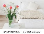 glass vase with pink tulips and ... | Shutterstock . vector #1045578139