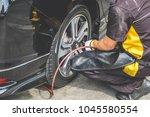 cropped shot of mechanic... | Shutterstock . vector #1045580554
