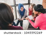 diverse women sitting in circle ... | Shutterstock . vector #1045592269