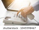 businessman dial digital... | Shutterstock . vector #1045598467