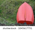 Red Dinghy Against Green...