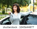 happy owner of a new car ... | Shutterstock . vector #1045644877