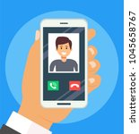 holding phone in hands and... | Shutterstock .eps vector #1045658767