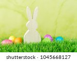 easter bunny with easter eggs... | Shutterstock . vector #1045668127