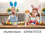happy easter  children girl and ... | Shutterstock . vector #1045673725
