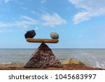 symbol of scales of stones on... | Shutterstock . vector #1045683997