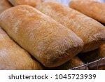 freshly baked bread in a shop... | Shutterstock . vector #1045723939