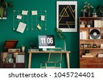 green home office interior with ... | Shutterstock . vector #1045724401