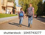 Two Kids Brothers With Backpack ...