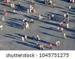 defocused image of people...   Shutterstock . vector #1045751275