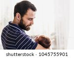 happy father holds his newborn... | Shutterstock . vector #1045755901