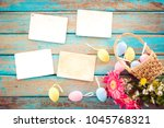 colorful easter eggs in nest... | Shutterstock . vector #1045768321