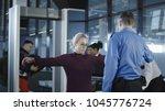 people going through procedure... | Shutterstock . vector #1045776724